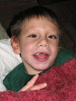 Photo of boy in a green shirt - Deafblind