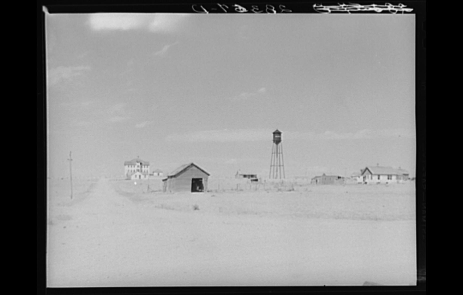 Photograph the the Keota school and water tower.