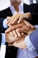 Team of business people stacking hands in team huddle