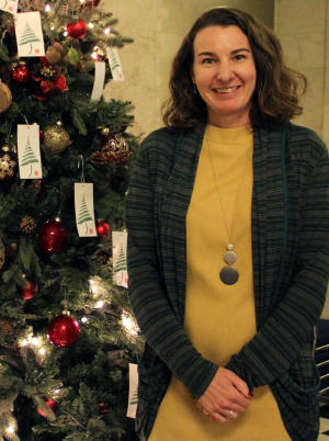 Photo of Education Commissioner Katy Anthes by Christmas Tree.