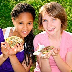 Stock photo of two children eating to represent Summer Food Service Program