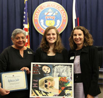Student artist Rebecca Suhr with state board member Val Flores and commissioner of education Katy Anthes.