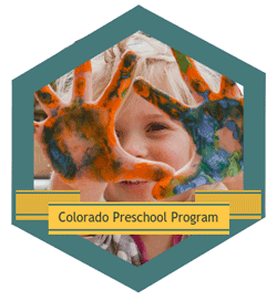 Preschooler with Paint on Hands