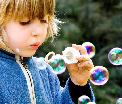 Child playing with bubbles