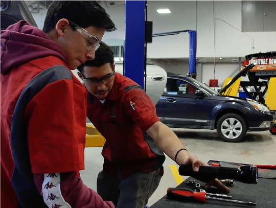 Student learning to work on cars for his ICAP