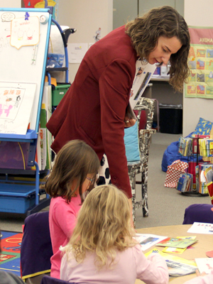 Photo of Commissioner Katy Anthes interacting with kindergartners at Fall River Elementary School in Longmont