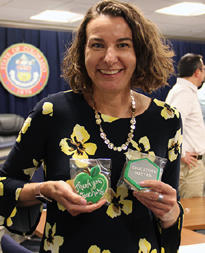 Katy Anthes holding cookies for teacher appreciation