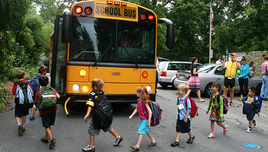 Children boarding a school bus